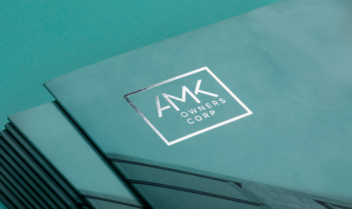 Close-up of AMK Owners Corp brochure cover